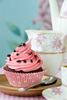 cup of tea and a pinkie cupcake